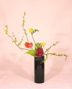 Vases for Nageire are cylindrical often tall and generally have a narrow mouth. In Nageire, stems are usually inserted into vases without using Kenzan (pinholder). There are various of methods to hold stems at the desired position.