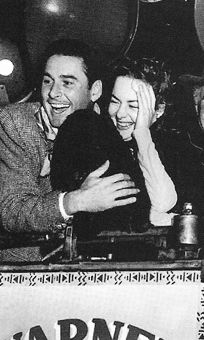 """Errol Flynn and Olivia de Havilland, en route to Santa Fe, New Mexico for the premiere of their film """"Santa Fe Trail"""" on December Old Hollywood Stars, Golden Age Of Hollywood, Vintage Hollywood, Classic Hollywood, Classic Movie Stars, Classic Movies, Errol Flynn, Actors Male, Olivia De Havilland"""