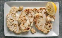 Roasted Cauliflower Steaks // A whole head of cauliflower can be sliced to create several large steaks. Roasting these cauliflower steaks along with the remaining florets is a fun and different way to enjoy this favorite seasonal vegetable.