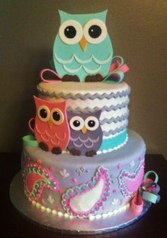 Love this owl cake  zig zags  with owl on top and little bows on bottom sides is what Lexi likes