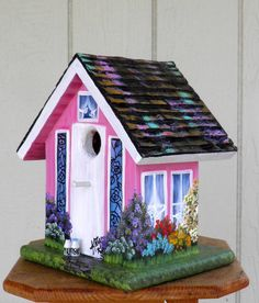 Outdoor Bird House, Handcrafted and Hand Painted, Yard or Home Decoration, Painted Pink with It's own Birdhouse, and Car in the Garage. $89.00, via Etsy.