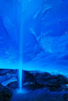 Glacial cave waterfall
