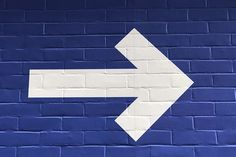 white arrow painted on brick wall photo – Free Arrow Image on Unsplash Compass Picture, Ketosis Symptoms, Arrow Image, Relation D Aide, Runner's World, Arrow Painting, Would You Rather Questions, My Well Being, Goals And Objectives