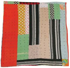 Quilts of Gee's Bend.  This one is by Helen McCloud, born 1938, blocks and strips tied with yarn in a grid pattern. Ca. 1965, cotton, nylon knit, polyester knit, 77 x 82 inches. This is one side of a two-sided quilt.