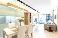 This sparkling white themed home looks perfect with modern lighting and shiny white tile flooring.Project by Icon Interior  #interiordesign #livingroom #renovation #cosy #home #sghomes #idsg #housedecor #renopedia #hdb #homestyling #furniture #furnishing #bedroom  #minimal #picoftheday #followme #follow #archidaily #beautiful #design #abstract