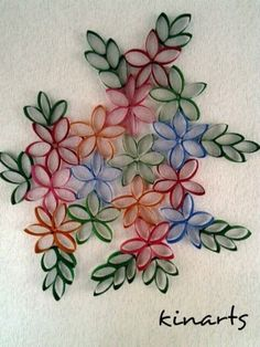 DIY : Toilet paper roll wall art.....cut paper rolls into five parts....paste them to make flowers and leaves and paint it to make a beautiful wall art.... by lucile