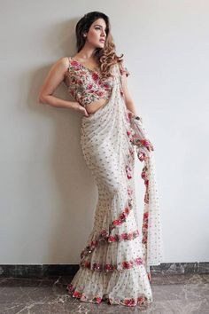 * Saree Type :- 3 Layer Ruffle. * Saree Color :- White. * Saree Work :- Beautiful Sequence Work * Saree Length : 5.50 M.  * Blouse Fabric :- Bangalory With Embroidery Work. * Blouse Length:- 0.90 M. * Blouse Type : Un-stitched .  * Wash Care :- First Wash Dry Clean. * Quality:- Good Quality Product.
