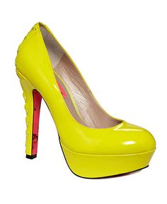 Bright neon Dita platform pumps. Featuring a sultry high heel with lace-up detail.