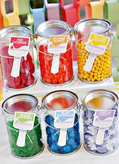 """The clear paint cans were my favorite party element,"" Shannon says. ""These were found at Michaels and filled with candy in every color and finished off with a personalized printable paint brush label.""  Source: Hostess With the Mostess - www.lilsugar.com"