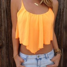 Orange/yellow crop top and jeans