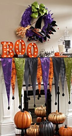 Marquee lights, feathered accents, and all that glitters–Hocus Pocus Mantel Scene sets the stage for a glamorous Halloween production.