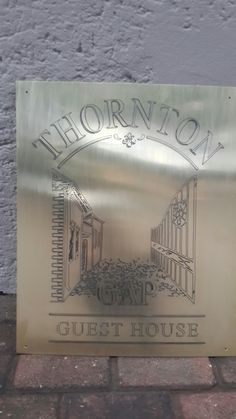 Image logo engraved on brass, paint filled with epoxy.