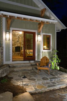 This simple patio invites you to sit and relax. A rustic Adirondack chair complements the bungalow-style design while red French doors add a pop of color to this neutral space. French Doors Patio, Patio Doors, French Doors Bedroom, Back Patio, Backyard Patio, Master Bedroom Addition, Flagstone Patio, Back Doors, Interior Exterior