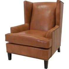 Wingback chair in cowboy with nailhead trim and foam cushions.     Product: ChairConstruction Material: Kiln dried hardwood frame and foam cushionsColor: CowboyFeatures:  Made in the USANailhead trimHigh resilency and high density cushions Dimensions: 42 H x 32 W x 39 D