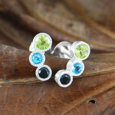 Stunning handmade sterling silver earrings incorporating unique blue topaz hues with a dazzling peridot semi precious stone - beautifully delicate and unique. #Embersjewellery #Jewellery #August #Birthstone #Peridot