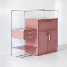 This B290 Cabinet by Bruno Weil is a museum-quality piece from 1932, unrestored, featuring its original coral-tone, lacquered block board, and stainless steel hardware.
