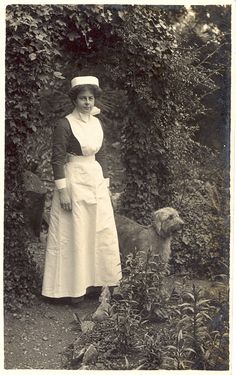 British nurse in a beautiful English garden - far away from the killing fields of Belgium and France. She is possibly the daughter or wife of a wealthy or titled Englishman who is doing her patriotic duty by becoming a nurse to care for the vast numbers of sick and wounded British soldiers. WW1