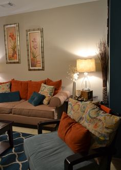 accent wall rugs coffee table pillows teal orange living room - Burnt Orange And Brown Living Room