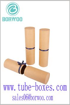 Brown kraft paper tube gift boxes. The middle part of the paper tube is decorated with a silk scarf gift ribbon, which can enhance the artistry of the packaging. Round Gift Boxes, Gift Boxes With Lids, Box With Lid, Custom Packaging, Packaging Ideas, Packaging Design, Gift Ribbon, Middle Parts, Kraft Paper