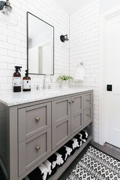 12 Bathrooms With Gray Cabinets That Will Melt Your Stress Away white bathroom with subway tile walls and gray vanity Large Bathrooms, Grey Bathrooms, Small Bathroom, Tiled Bathrooms, White Subway Tile Bathroom, White Vanity Bathroom, Bathroom Vanities, Bathroom With Tile Walls, Bathroom Furniture