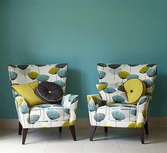 Dandelion-clocks-wing-armchairs- modern Sanderson fabric, retro and perfect teamed with deco furnishings and kitchenware, Keva xo Clock Wallpaper, Retro Wallpaper, Pattern Wallpaper, Sanderson Fabric, Dandelion Clock, Cool Chairs, Easy Chairs, Lounge Chairs, Awesome Chairs