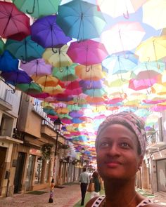 Umbrellas as Street Art in Águeda, Portugal. This cool art installation is part of the Umbrella Sky Project. Floating umbrellas in a rainbow of colors. http://vaycarious.com/2016/11/28/why-portugal-will-be-your-favorite-travel-destination/