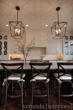 two-tone kitchen with beautiful symmetry #lighting and chairs
