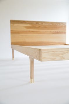 SIMPLE BED by Kalon Studios. Solid Ash bed frame with brass hardware details. Making use of simple woodworking techniques, the Simple Collection offers purity of material, form and function. The pared back collection creates a tranquil space of simple and unobtrusive beauty. Sustainably made in the USA.