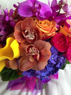 Orchids are not your typical garden flower, but we often use these blooms, to celebrate the intensity of summer because of their vibrant colors.