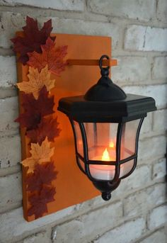 Reuse pathway lights by spray painting them and drilling them to a board, adding a tea light and hang. (Thrift Diving)