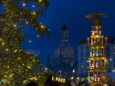 Soooo beautiful...Dresden's landmark the Church of Our Lady can be seen behind a Christmas tree and a Christmas pyramid