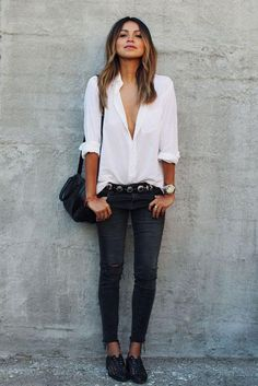 Try Sincerely Jules' easy way to wear black ripped jeans: Tuck in a white button-down and wear a cool belt. Click for more outfit ideas!