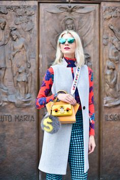 The Eye Travels, Samantha Angelo, MFW, Milan Fashion Week, Fendi, Fendi Fashion Show, Fendi F/W 2016, MFW F/W 2016, Milano, Monster Baguette, Fendi Handbag, Fendi Strap, Fendi Studded Strap, Yellow Fendi Handbag, Fendi Fur, Illestevia Sunglasses, Sunglasses, Green Reflective Sunglasses, Bottega Veneta Polka Dot Pants, Marc by Marc Jacobs Sweater, Floral Sweater, Intermix Sleeveless Vest, Intermix Sleeveless Coat, Pink Chanel Boots, Chanel Booties, Spring Fashion, Colorful, Style Blog, Style…