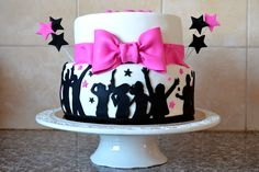 Dancing silohuettes bat mitzvah cake with bow.