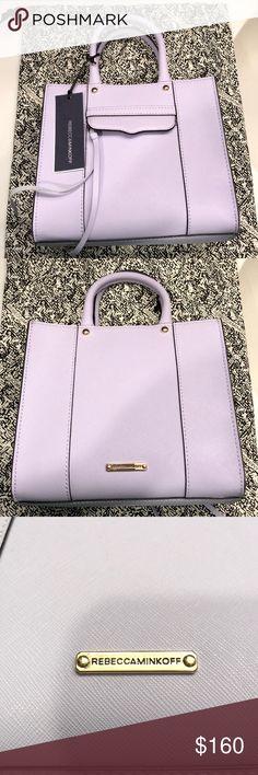 "Rebecca Minkoff MAB Tote Mini in Lilac New Authentic Rebecca Minkoff MAB Tote Mini in the color 'Lilac.' This style can be carried or worn crossbody. Dimensions are 8""W x 3""D x 7""H. Double top handles, detachable adjustable crossbody strap, snap closure, exterior zip pocket with tassel, interior slip pocket. New with tags. Strap & dust bag included! Rebecca Minkoff Bags"