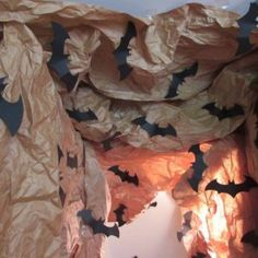 brown kraft paper crumpled up to create bat cave. Bat signal cut out in - Batman Decoration - Ideas of Batman Decoration - brown kraft paper crumpled up to create bat cave. Bat signal cut out in black paper as bats leading down into the bat cave. Noche Halloween, Halloween Forum, Halloween Party Themes, Halloween Bats, Halloween Projects, Diy Halloween Decorations, Halloween 2019, Batman Decorations, Batman Logo