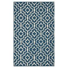 """Anchor your living room seating group or define space in the den with this artfully hand-tufted wool rug, featuring a quatrefoil-inspired trellis motif for eye-catching appeal.   Product: RugConstruction Material: Wool and cotton canvasColor: Navy blue and ivoryFeatures:  Hand-tuftedCotton canvas backingPile Height: 0.63"""" Note: Please be aware that actual colors may vary from those shown on your screen. Accent rugs may also not show the entire pattern that the corresponding area rugs ..."""