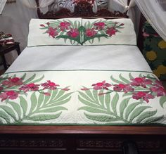 "26"" x 88"" stitched quilted bed runner and matching pillow shams, in assorted shades of pinks, purples and greens."