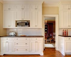 Traditional Kitchens | CABICO - feet on butler pantry bottom cabinets and drawers like this!  All white? or continue two tone?