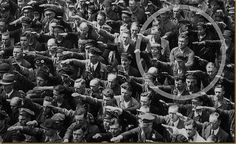 Ordinary people. The courage to say no.     The photo was taken in Hamburg in 1936, during the celebrations for the launch of a ship. In the crowed, one person refuses to raise his arm to give the Nazi salute. The man was August Landmesser. He had already been in trouble with the authorities, having been sentenced to two years hard labour for marrying a Jewish woman.