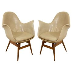 A Pair of Danish Style Leather Upholstered Chairs. Denmark.  1950/60's.