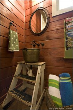 antique step ladder turned sink -- would be great for outdoor hand washing station for all ages!