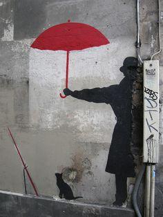 Seen opposite Notre Dame in Paris, this work of street art is credited to English graffiti artist Banksy. Graffiti Artwork, Street Art Graffiti, Banksy Graffiti, Arte Black, Art Public, Urbane Kunst, Umbrella Art, Umbrella Street, Chalk Art
