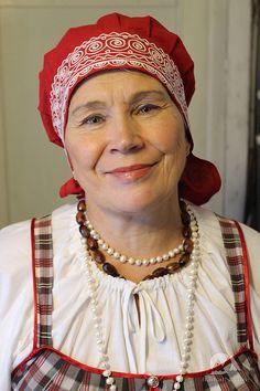 (Karelian people) Karelian woman in traditional dress. Siberia, Russia.
