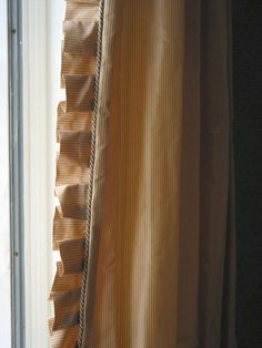 drapery details - silk curtains with box-pleat ruffle and cording - about.com via atticmag
