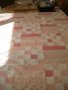 Beatrice Quilt. Needs 2 jelly rolls 1 color one white. Was able to make 7 blocks across and 8 rows. Strips are 8 1/2 and the blocks are 2 1/2 in. Quick and easy. Now to quilt it.