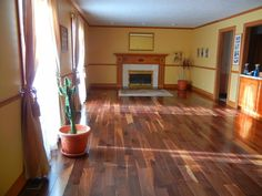 "Natural American Walnut (featured in Dream Home 2007) in a customer home! ""After 25 years of carpet I wanted to update my family room. I had installed the Bellawood Koa in my foyer and liked the results so much that I wanted to use this project in my family room. I decided on the American Walnut because of the caramel and chocolate hues. There is a large variety to the grains and color of this wood and makes for a unique floor. I am very pleased with the results."""