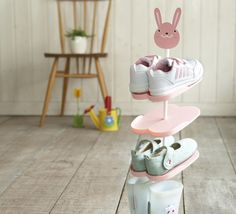Kids Shoe Rack | The cutest and most practical kids shoe rack I've seen. It fits most styles of shoes including gumboots and its design is so kid friendly that your little ones can easily store and grab their shoes. Compact enought to sit at the door for getting out the door quicker. #kidsshoerack #shoerack #kidsstuff #kidsshoes #childrensstorage #shoestorage #childrensshoerack