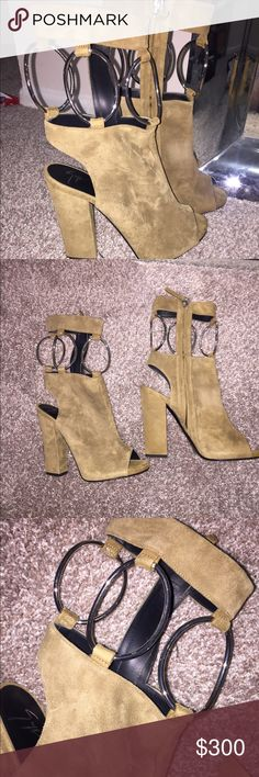 Fall 2016 Giuseppe Zanotti open toe boot Brownish olive colored Suede. Be uninhibited and indulge in being boho chic with Giuseppe Zanotti™.  Nubuck leather upper. Zip closure detail. Circular rings attached to slender strap encompassing ankle. Peep-toe silhouette. Leather lining and insole. Triangular chunk heel. Leather outsole with heel taps. Made in Italy. Giuseppe Zanotti Shoes Ankle Boots & Booties