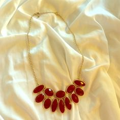 Maroon and gold necklace Maroon stone and gold necklace. Jewelry Necklaces